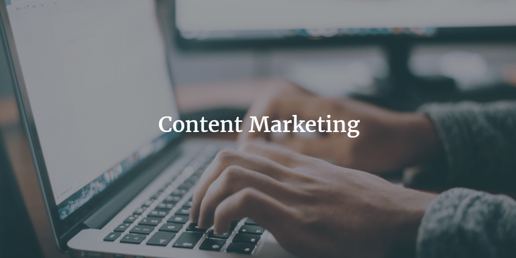 writing on a laptop - content marketing for small businesses
